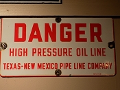 1953 Texas-New Mexico Danger Porcelain Pipe Line Sign